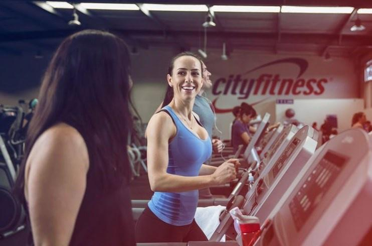 Woman Working Out At City Fitness